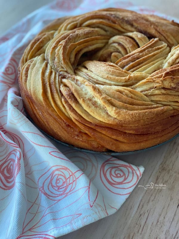 Russian rose bread without powdered sugar on wooden surface