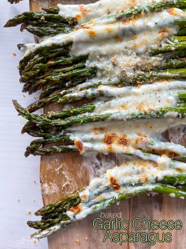 Top view of asparagus topped with melted cheeses