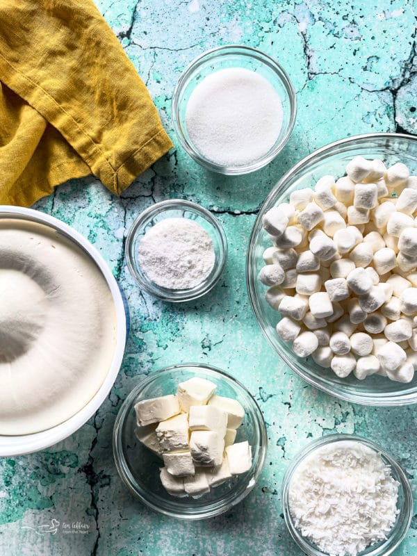 Bowl of Cool Whip and ingredients for pineapple fluff recipe