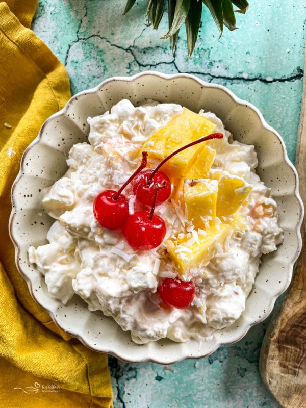 Top view of piña colada fluff salad with cherries