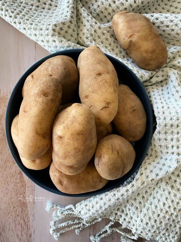 Top view of russet potatoes in blue bowl