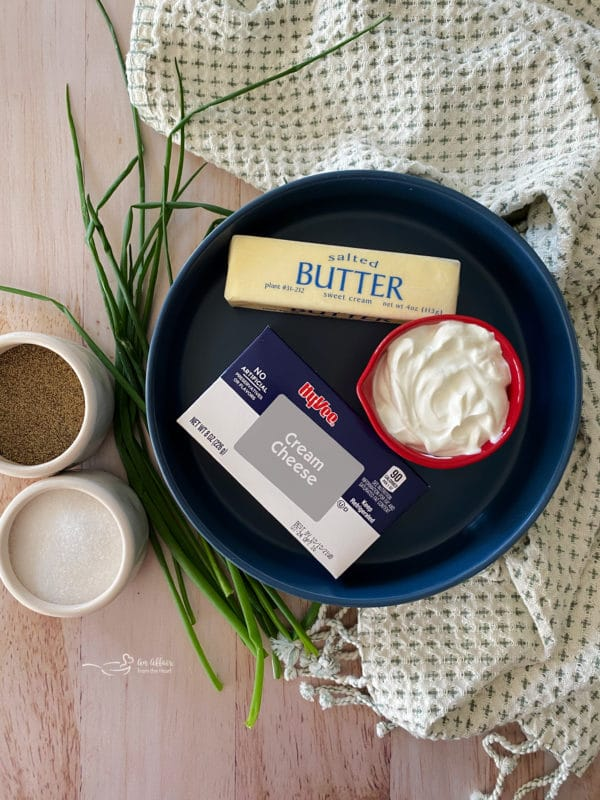 Butter, salt, pepper, and cream cheese for the best mashed potatoes in the slow cooker