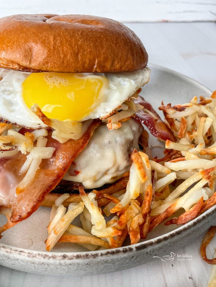 Hangover Burger plated with shredded hashbrowns