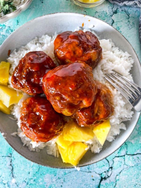 Close view of Hawaiian ham balls with pineapple sauce