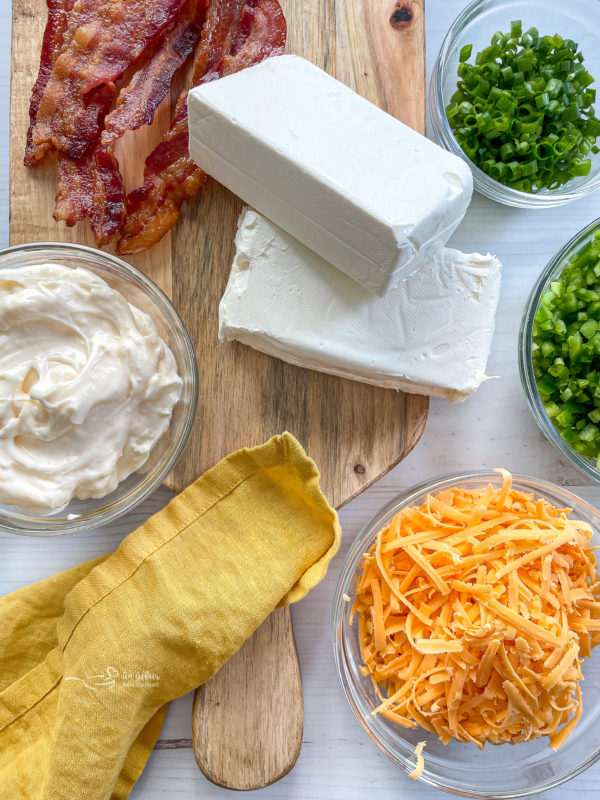 cream cheese, cheddar cheese, sour cream, fresh herbs, green onions, bacon