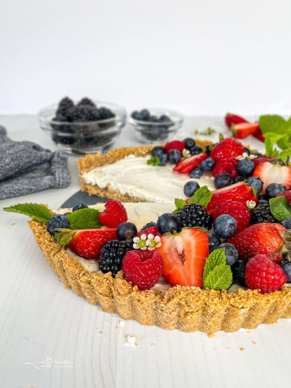 Front view of no bake fruit tart with berries