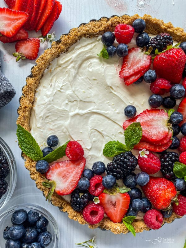 Top view of no bake fruit tart with fresh blueberries, strawberries, blackberries, and raspberries