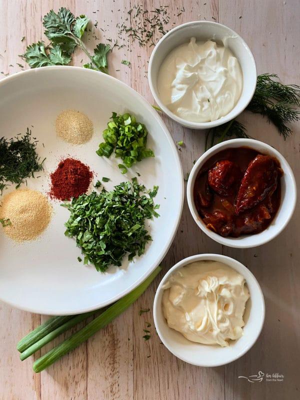 herbs, chili, seasoning, scallions, mayo, adobo sauce, and sour cream