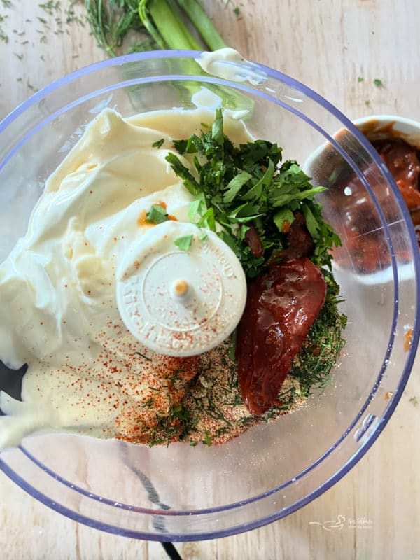 top view of food processor with sour cream and mayonnaise