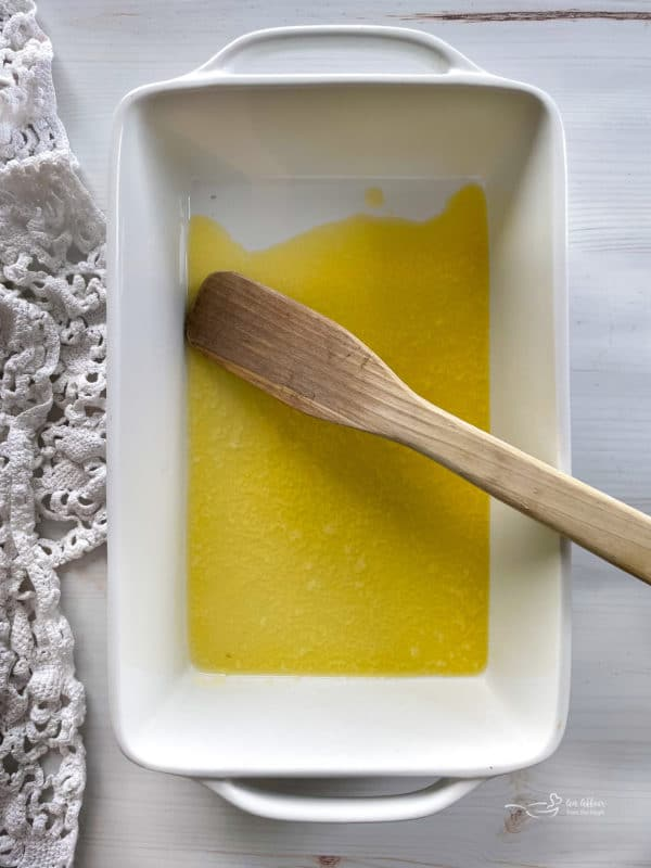 melted butter in baking dish