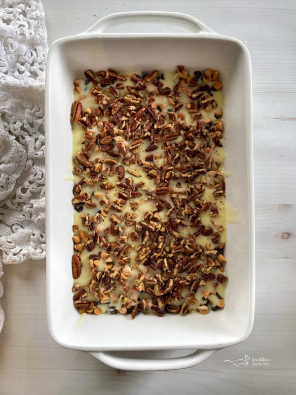 top view of sweetened condensed milk with pecans and butterscotch chips