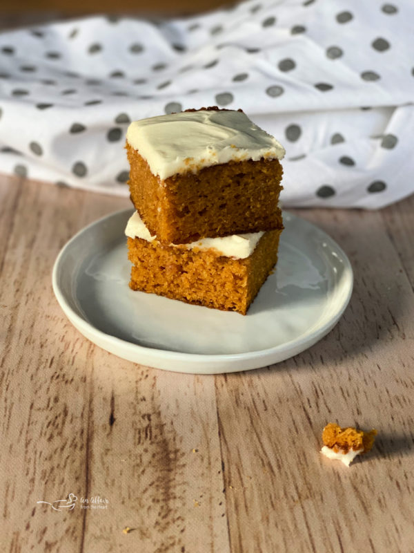 two carrot cake bars with cream cheese frosting