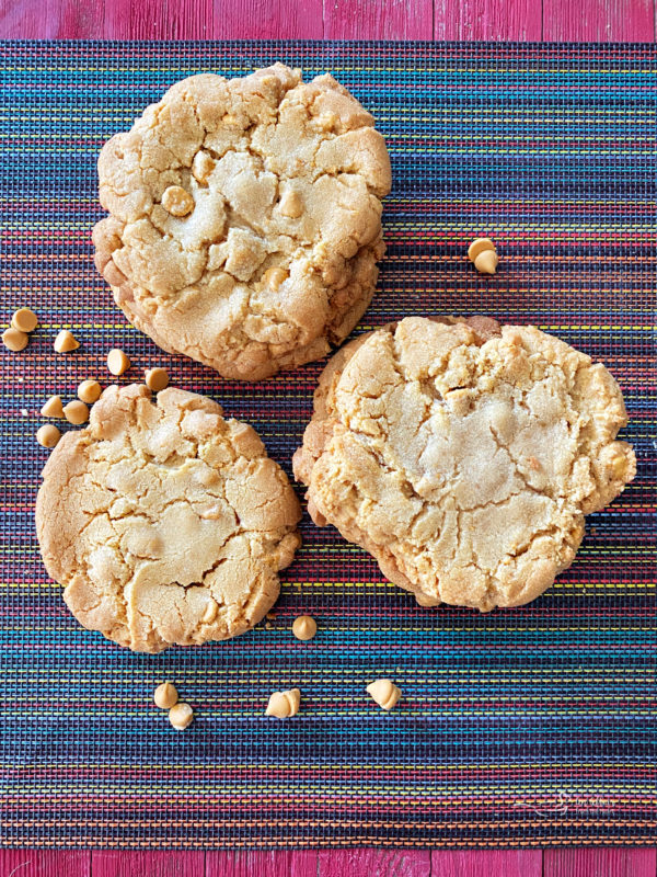three butterscotch cookies on a surface