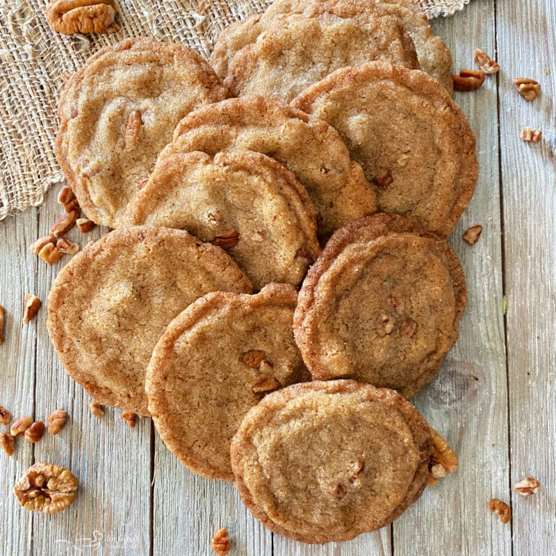 one group of pecan cookies on surface with pecans