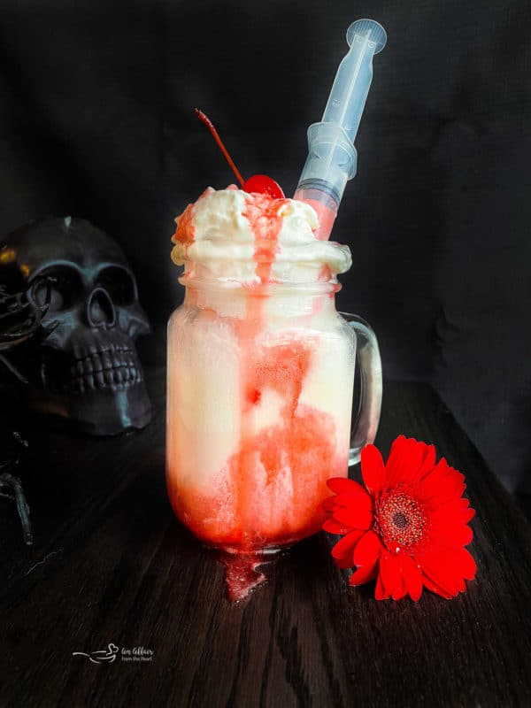 bloody dirty shirley float with a syringe
